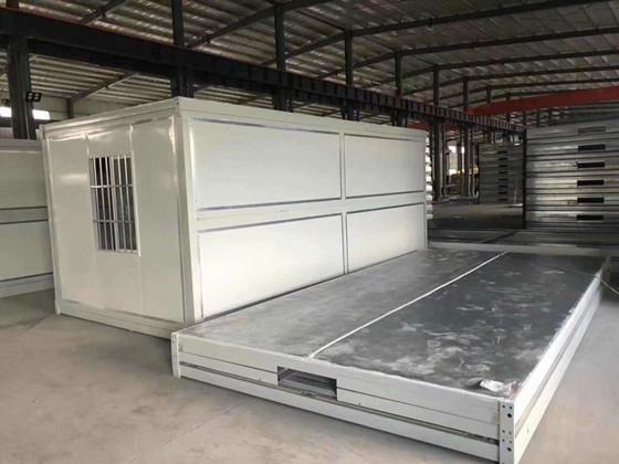 库房压缩垂着高度为400mm的折叠箱式活动房